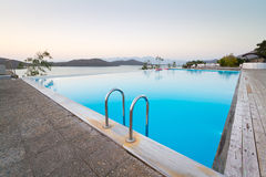 Blue swimming pool at Mirabello Bay of Greece. Blue swimming pool with Mirabello Bay view on Crete, Greece Royalty Free Stock Photography