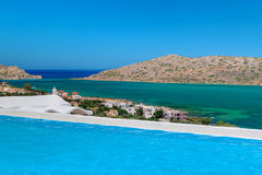 Blue swimming pool with Mirabello Bay view on Cret Royalty Free Stock Image