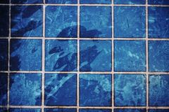 Blue swimming pool rippled water Stock Image