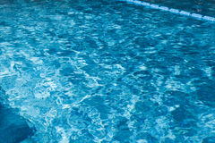 Blue swimming pool rippled water Royalty Free Stock Photos