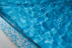 Blue swimming pool rippled water Royalty Free Stock Photo