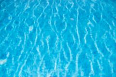 Blue swimming pool rippled water detail Stock Photo