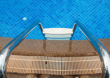 Blue swimming pool with stair at hotel Royalty Free Stock Photos