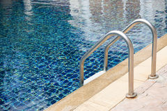 Blue swimming pool with stair Stock Photo
