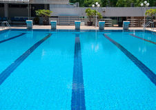 Blue swimming pool and starting places at sport center Stock Photo
