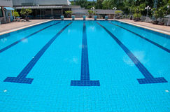 Blue swimming pool and starting places at sport center Royalty Free Stock Photos