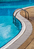 Blue swimming pool with steps Royalty Free Stock Images