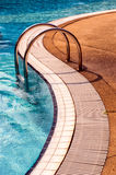 Blue swimming pool with steps Stock Image