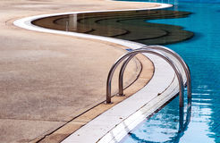 Blue swimming pool with steps Royalty Free Stock Photo