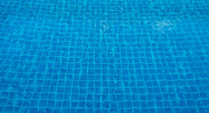 Blue swimming pool in sunlight Background Royalty Free Stock Photo