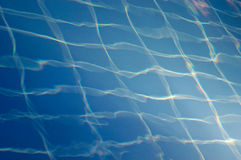 Blue Swimming Pool Tiles Though Water Royalty Free Stock Image