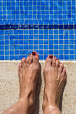 Blue swimming pool water rippled detail Stock Photos