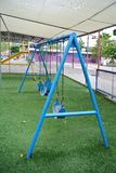 Blue swing for kids. The blue swing for kids Stock Photography