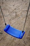 Blue swing play stock photo