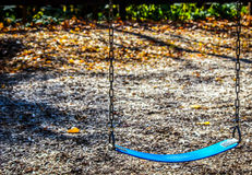 Blue Swing on Playground Stock Images