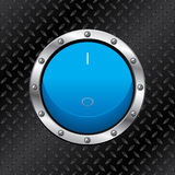 Blue switch on dark plate Royalty Free Stock Photography