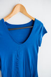 Blue t-shirt hanging on hanger Stock Image