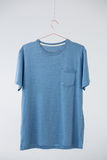 Blue t-shirt with pocket hanging on hanger Stock Image