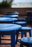 Blue table. Tables and chairs colored in blue Stock Photography