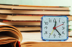Alarm clock and books. Royalty Free Stock Images