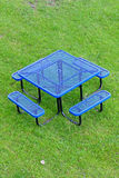 Blue table and chair on grassland Royalty Free Stock Photography