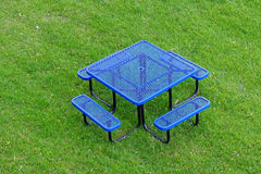 Blue table and chair on grassland Stock Images