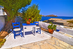 blue table and chairs at Sifnos Greece Stock Photography