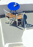 Blue table and chairs on terrace in Oia, Santorini, Cyclades, Gr Royalty Free Stock Image