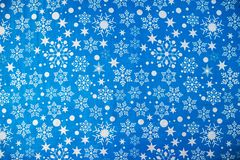 Blue tablecloth with a New Year`s print snowflakes. Fabric texture royalty free stock photos