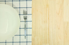 Blue tablecloth and white plate,fork Royalty Free Stock Images
