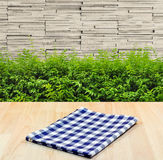 Blue tablecloth on wood material background Stock Photos