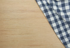 Blue tablecloth on wooden table. Royalty Free Stock Photography