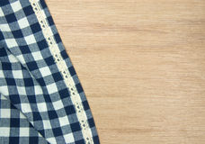 Blue tablecloth on wooden table. Royalty Free Stock Photo