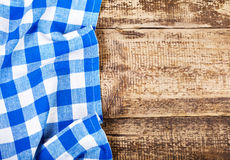 Blue tablecloth on  wooden table Royalty Free Stock Image