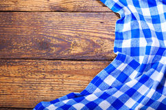 Blue tablecloth on wooden table Royalty Free Stock Photo