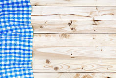 Blue tablecloth on wooden table, top view. Blue checkered tablecloth on a light wooden table, top view Royalty Free Stock Photos