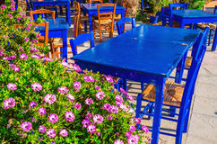 Blue tables in colorful Greek restaurant, Greece Royalty Free Stock Photography