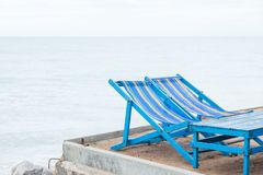 Blue tables and couches. To relax on the sandy beach Stock Photo