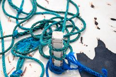 Free Blue Tackle On Rustic White Boat Abstract Photo. Rustic Blue Rope On White Wood. White Yacht Exterior Detail Royalty Free Stock Image - 137635176