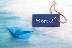 Blue Tag with Merci Royalty Free Stock Image