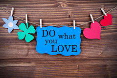 Blue TagWith Phrase Do What You Love On It Hanging on a Line royalty free stock photos