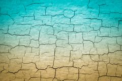 Blue and Tan Cracked Paint stock photography