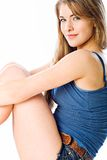 Blue tank top. Profile of Natalie dressed in blue tank and blue jean shorts Stock Image