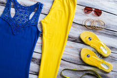 Blue tank top and sunglasses. Royalty Free Stock Image