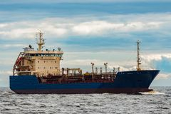 Blue cargo tanker ship. Blue tanker. Toxic substances and petroleum products transfer Royalty Free Stock Images