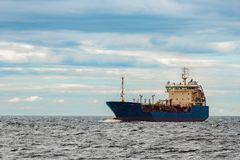 Blue cargo tanker ship. Blue tanker. Toxic substances and petroleum products transfer Stock Photos
