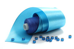 Blue tape and blue threads Stock Photography