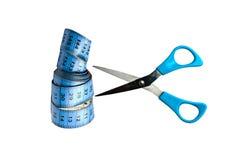 Blue tape measure and scissor stock photo
