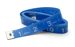 Blue Tape Measure. Sewing Tape measure rolled up Isolated on White Back Ground Royalty Free Stock Photo