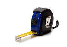 Blue tape measure on a white background Stock Photos